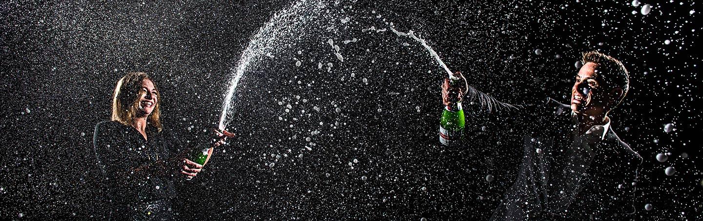 J. La Plante Photo | Denver Wedding Photographers | Denver Engagement | Bride and Groom Spraying Champagne