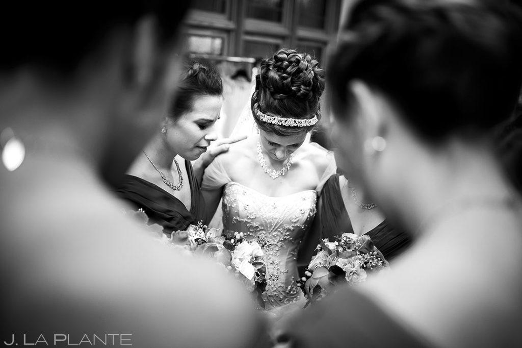 bridesmaids praying before wedding ceremony