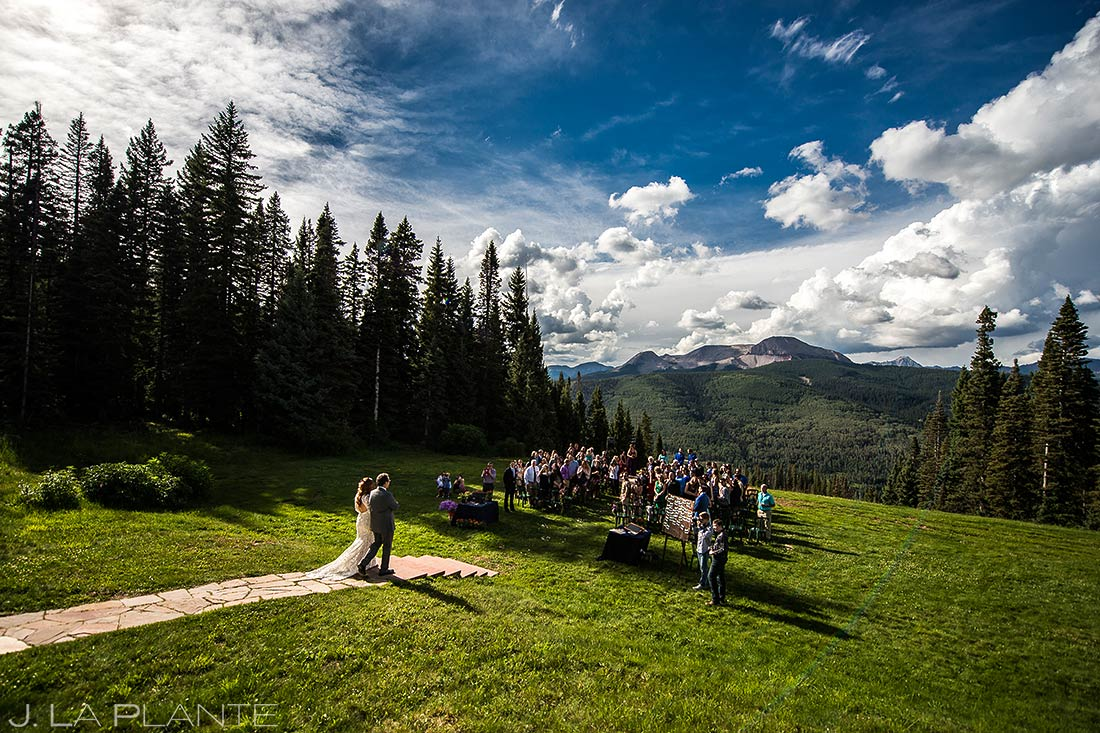 father walking his daughter down the aisle during a wedding ceremony at purgatory resort