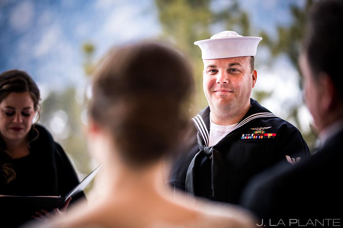 Groom watching bride walk down aisle | Black Canyon Inn Winter Wedding | Rocky Mountain Wedding Photographer | J La Plante Photo