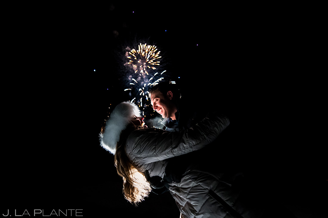 bride and groom watching fireworks during their beaver creek engagement