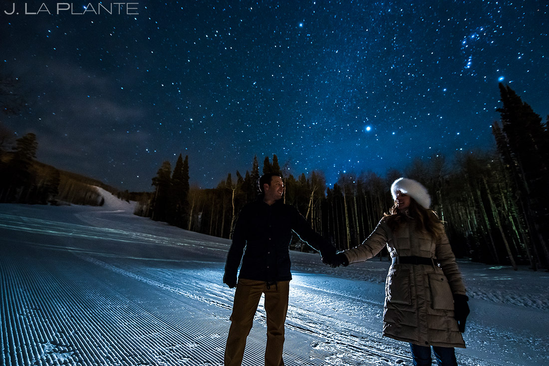bride and groom under the stars during their beaver creek engagement