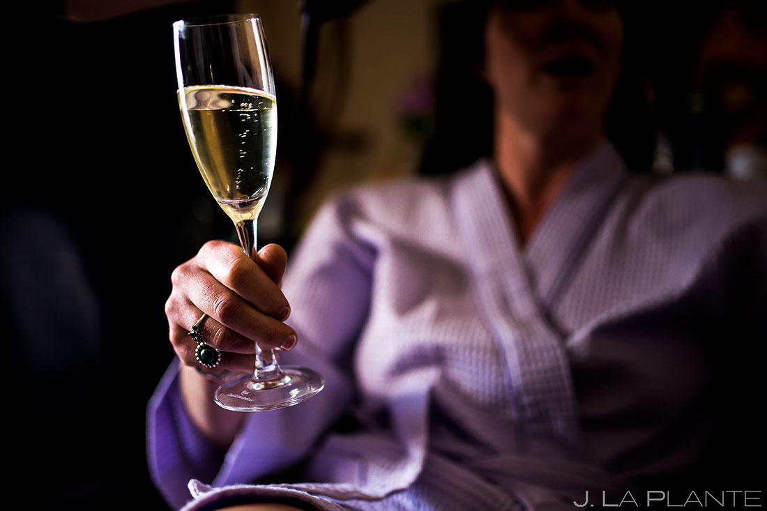 Bride drinking champagne | Evergreen Lake House Wedding | Evergreen Wedding Photographer | J. La Plante Photo