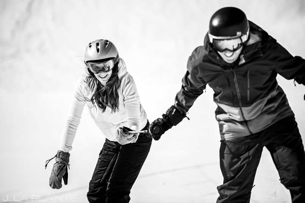 bride and groom skiing together
