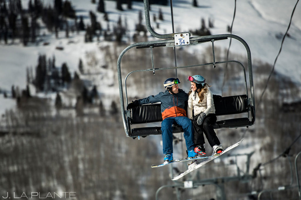 bride and groom riding chairlift