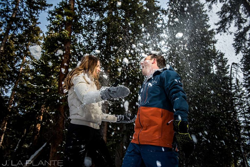 Vail Ski Engagement   Bride and groom playing in snow   Vail wedding photographer   J. La Plante Photo