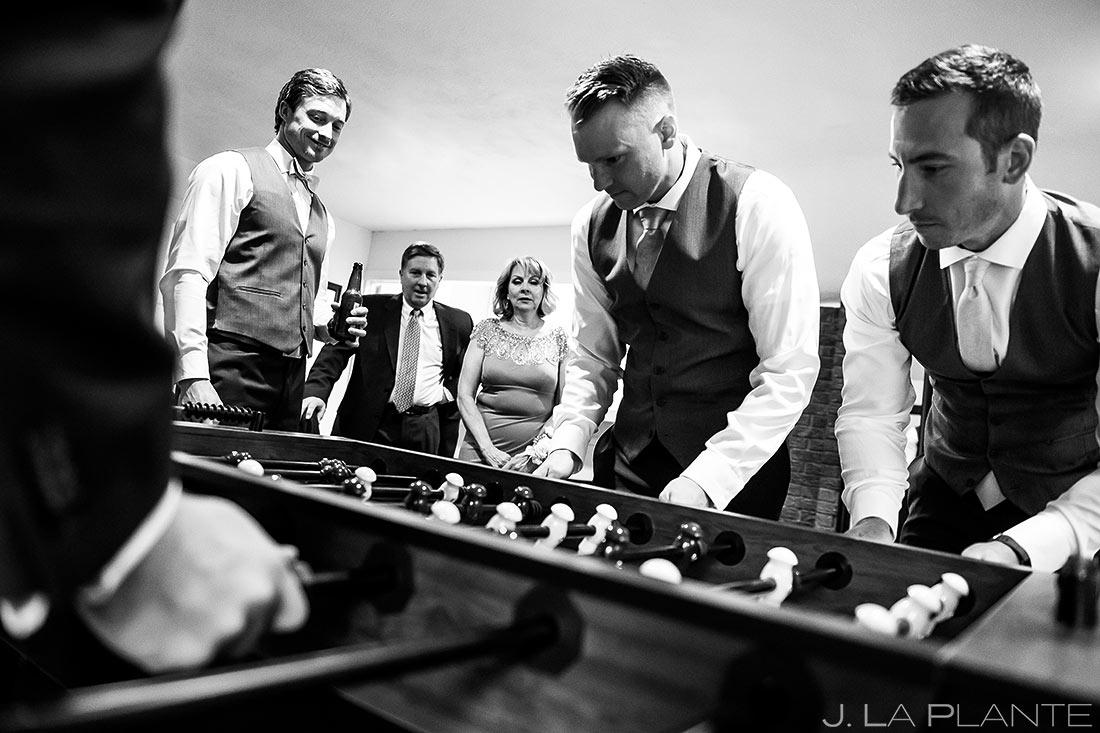 Groomsmen Playing Foosball   Wedgewood Boulder Creek Wedding   Boulder Wedding Photographer   J. La Plante Photo
