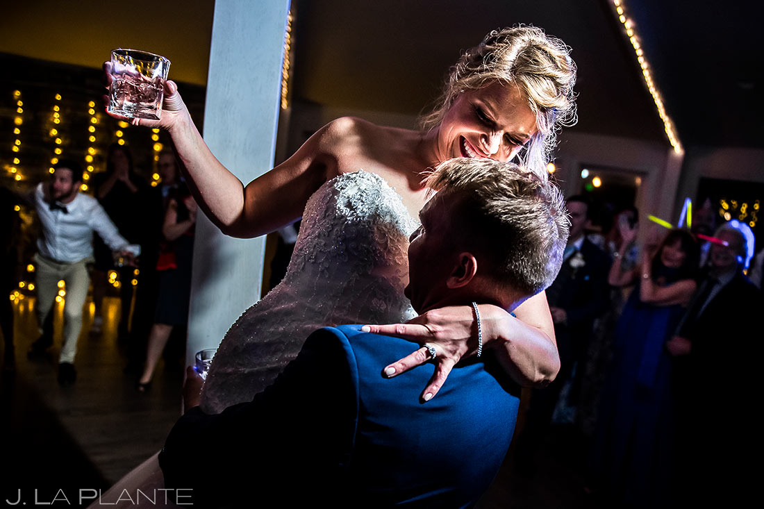 bride and groom cutting a rug on the dance floor