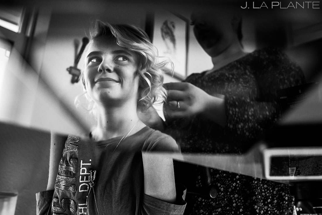daughter of bride getting her hair done at white owl ranch wedding