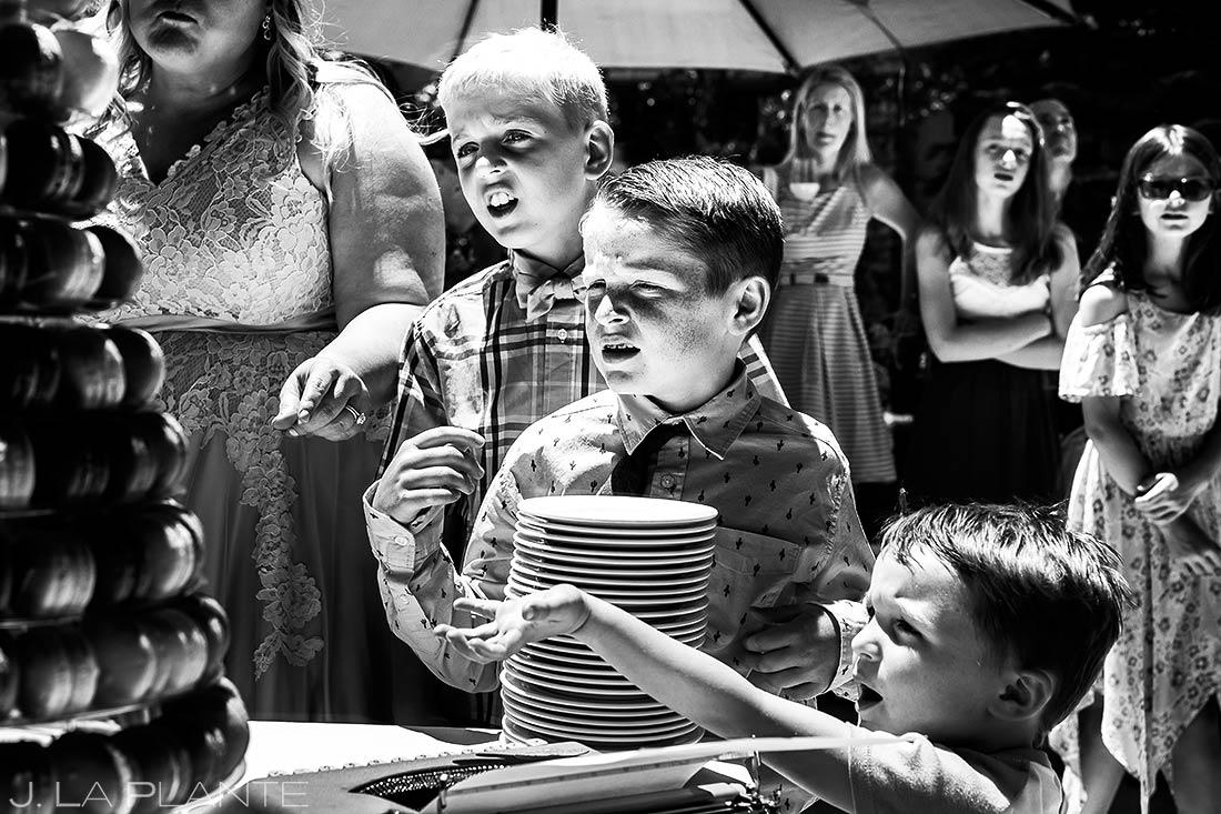 Kids Reaching for Wedding Cake | Revolution Dining Wedding Reception | Colorado Wedding Photographer | J. La Plante Photo