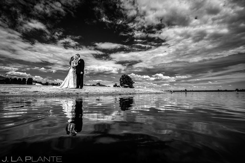 black and white portrait of bride and groom on the beach
