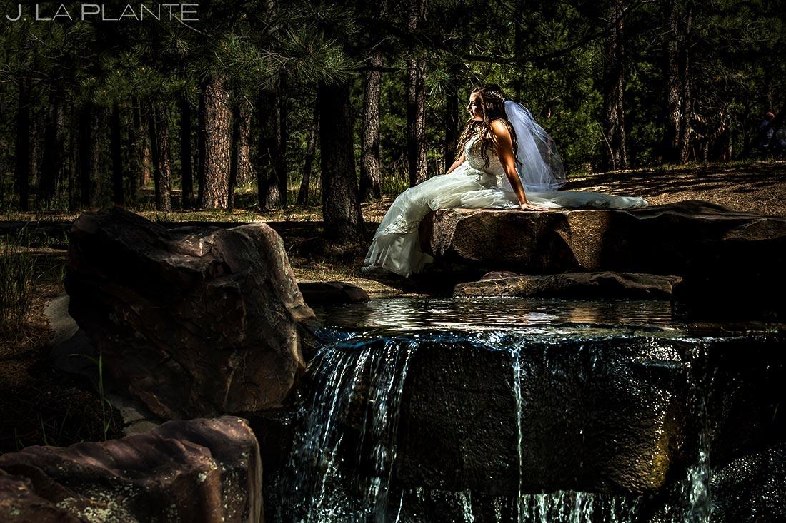 Portrait of Bride by Waterfall   Colorado Springs Wedding Photographer   J. La Plante Photo
