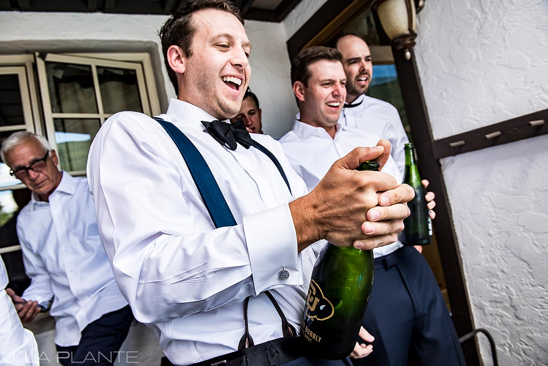 Groom Popping Bottles | Camp Hale Wedding | Vail Wedding Photographer | J. La Plante Photo