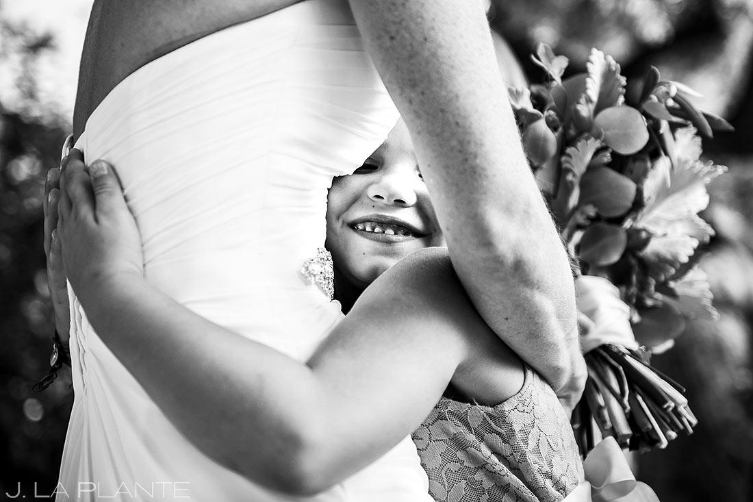 Bride Hugging Flower Girl | Chautauqua Park Wedding | Boulder Wedding Photographer | J. La Plante Photo