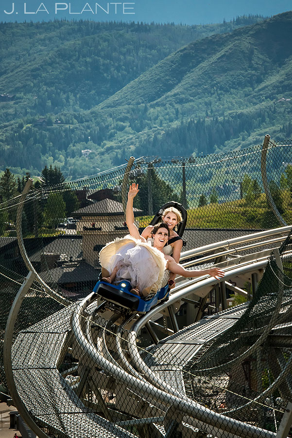 Bride and Bride Riding Roller Coaster | Steamboat Springs Wedding | Colorado Wedding Photographer | J. La Plante Photo