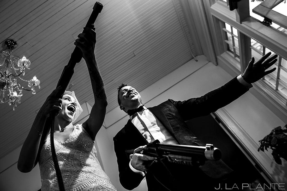 Bride and Groom Playing Big Buck Hunter | Manor House Wedding | Denver Wedding Photographer | J. La Plante Photo