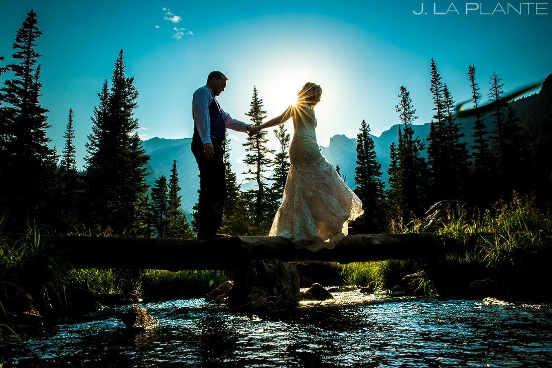 Bride and Groom Crossing River | Rocky Mountain National Park Wedding | Estes Park Wedding Photographer | J. La Plante Photo