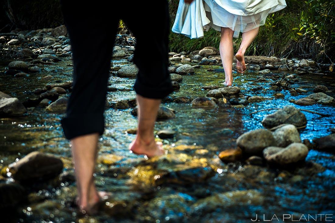 Bride and Groom Wading Through River | Buena Vista Wedding | Rustic Mountain Wedding | Colorado Wedding Photographer | J. La Plante Photo