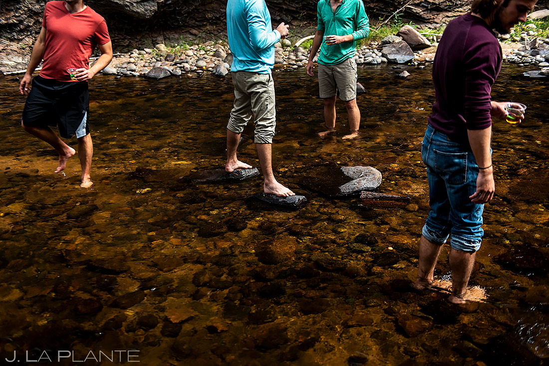Groomsmen Hanging out in River | Planet Bluegrass Wedding | Boulder Wedding Photographer | J. La Plante Photo