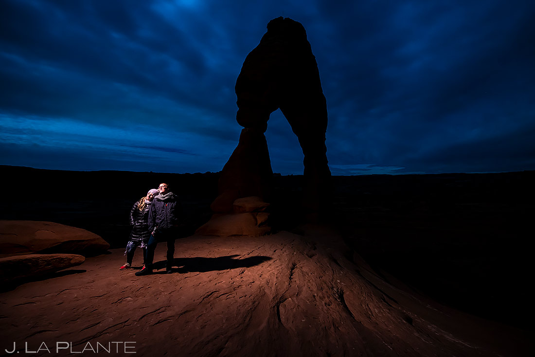 Bride and Groom at Delicate Arch | Moab Engagement | Destination Wedding Photographer | J. La Plante Photo