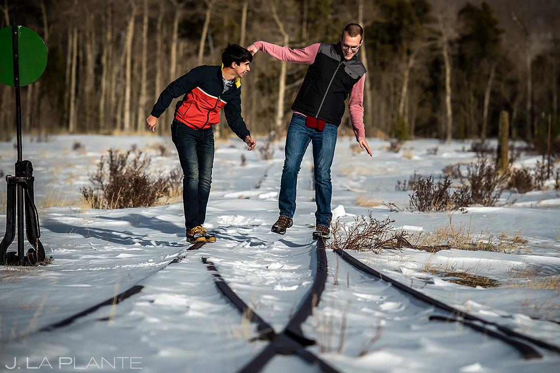 Groom and Groom Hiking in Aspens | Colorado Pre Wedding Photo Session | Colorado Wedding Photographers | J. La Plante Photo