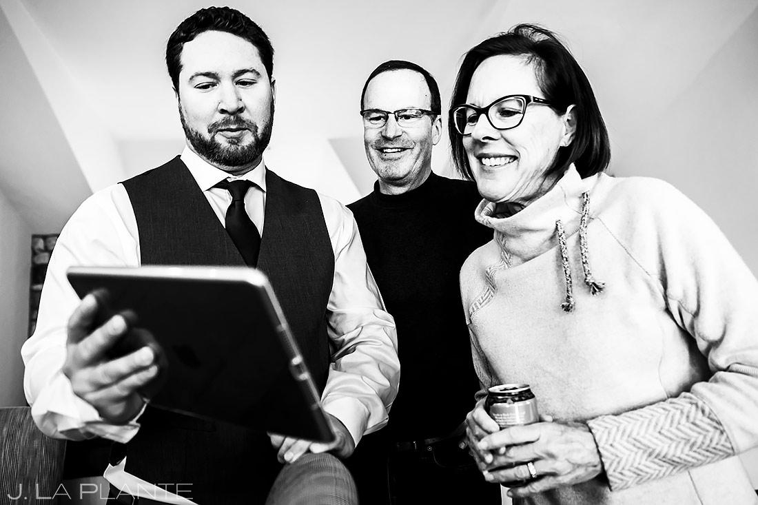 Groom Skyping with Sister   Sonnenalp Club Wedding   Beaver Creek Wedding Photographer   J. La Plante Photo