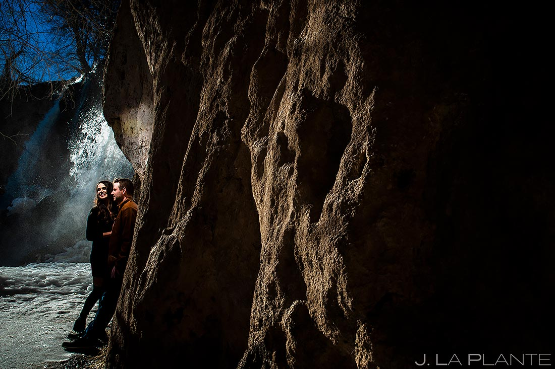 Bride and Groom by Waterfall | Colorado Pre Wedding Photo Session | Colorado Wedding Photographers | J. La Plante Photo
