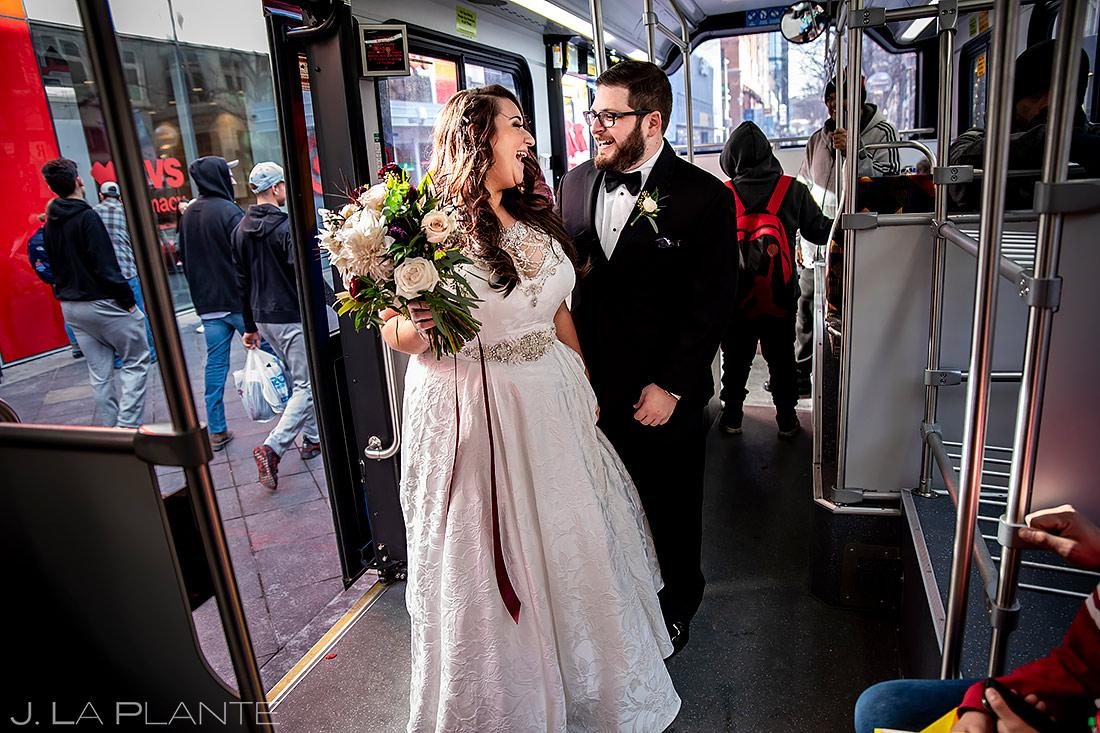 Bride and Groom Riding 16th Street Mall Bus | Urban Wedding in Colorado | Colorado Wedding Photographer | J. La Plante Photo