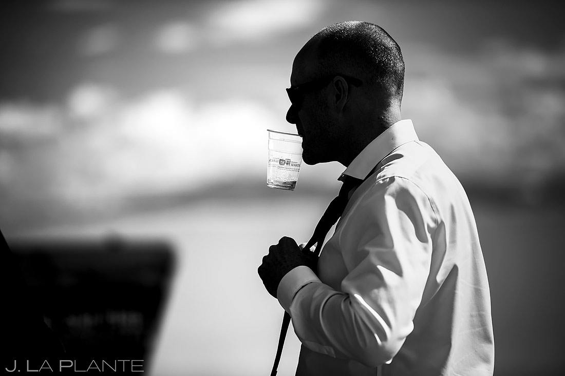 Groom Drinking Whiskey | Bonneville Salt Flats Engagement | Destination Wedding Photographer | J. La Plante Photo