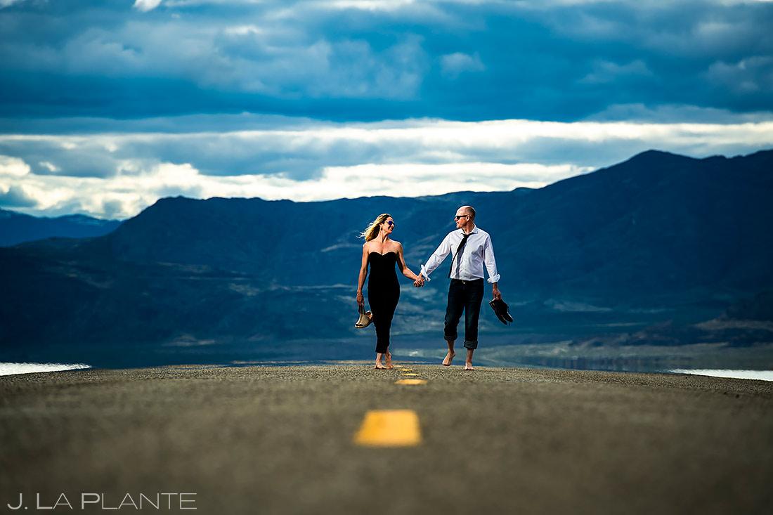 Bride and Groom Walking Barefoot | Bonneville Salt Flats Engagement | Destination Wedding Photographer | J. La Plante Photo