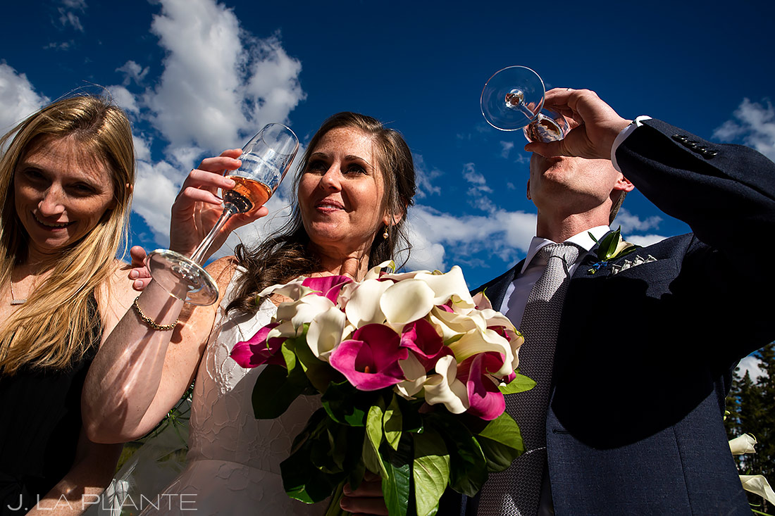 Bride and Groom Drinking Champagne   Breckenridge Wedding   Breckenridge Wedding Photographer   J. La Plante Photo