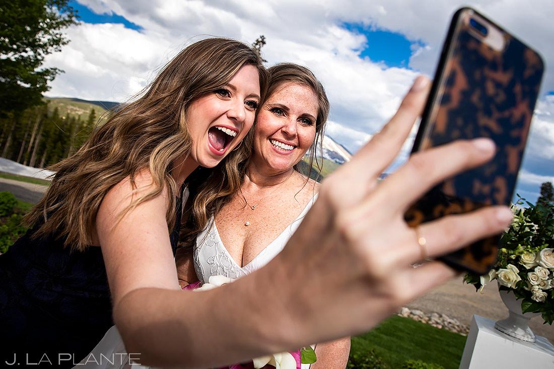 Bride Taking Selfies   Tenmile Station Wedding   Breckenridge Wedding Photographer   J. La Plante Photo