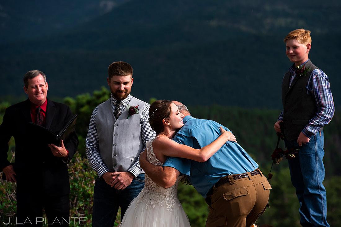 Bride Hugging Father | 3M Curve Wedding | Rocky Mountain National Park Wedding Photographer | J. La Plante Photo
