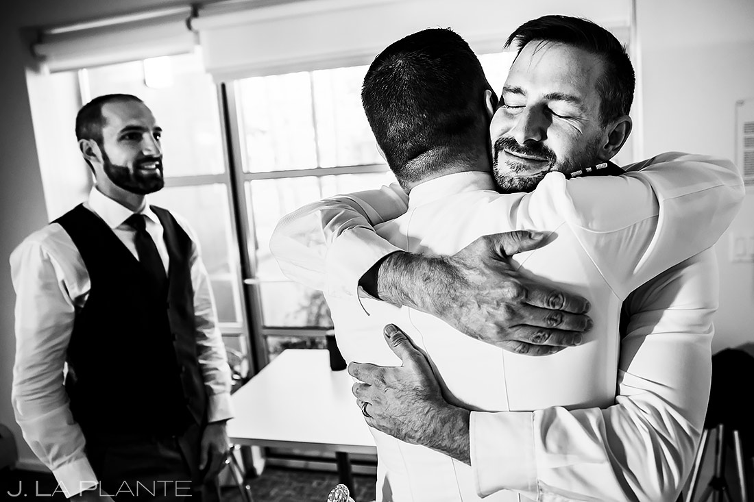 groom hugging the best man before wedding ceremony