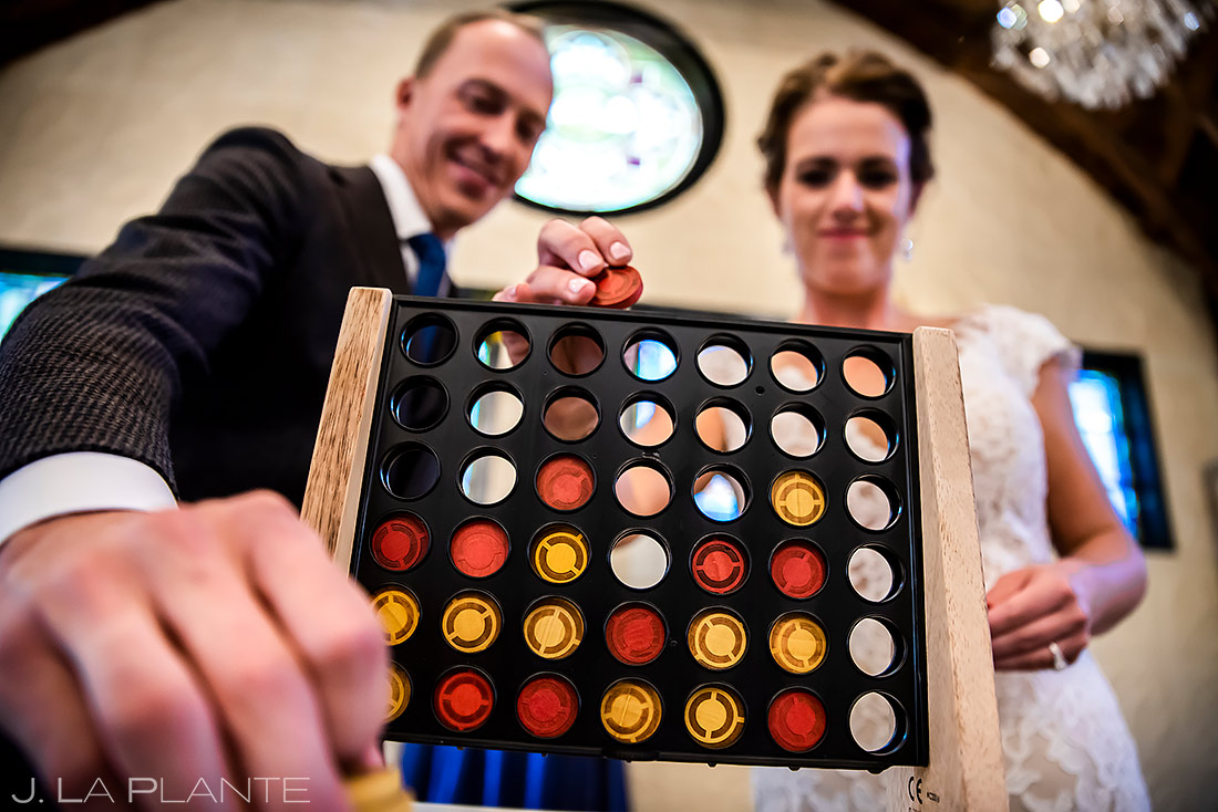 Bride and Groom Playing Connect 4 | Boulder Photographer | J. La Plante Photo