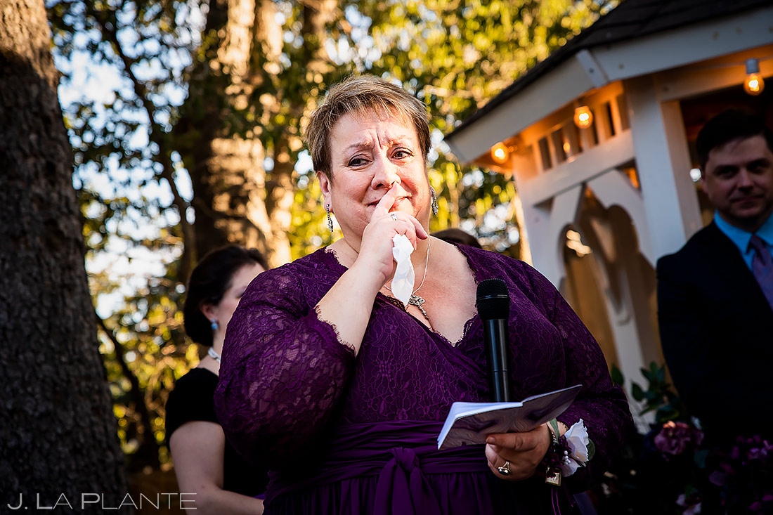 mother of the bride crying while giving a speech