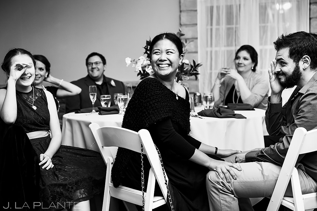 wedding guests laughing during toasts