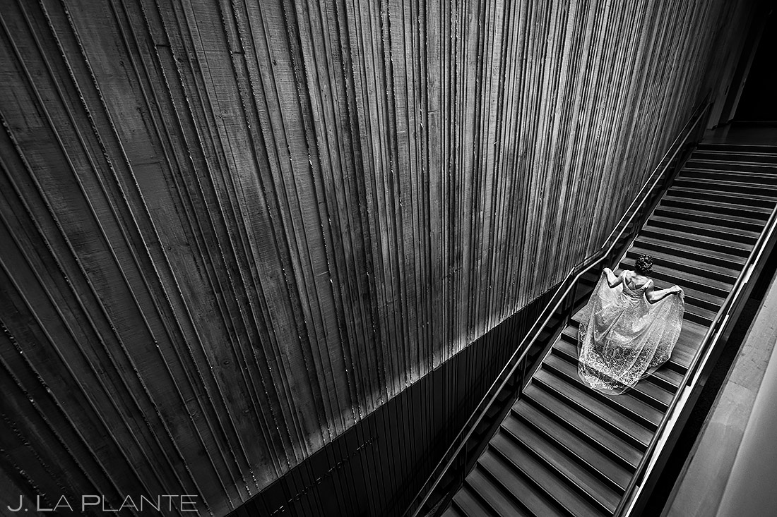 cool photo of bride in her dress walking up a staircase