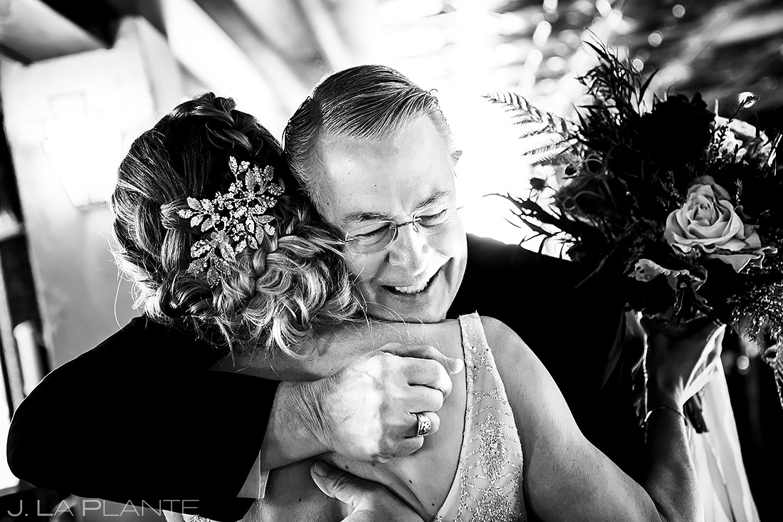 bride hugging her father during ceremony