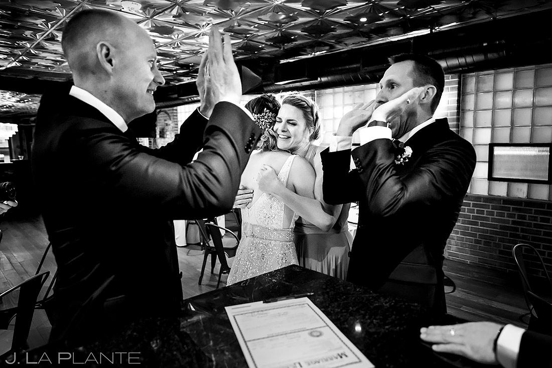 Groom high fiving best man | Denver Wedding Photographer | J. La Plante Photo