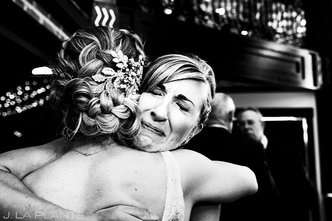 bride hugging guest denver photographer