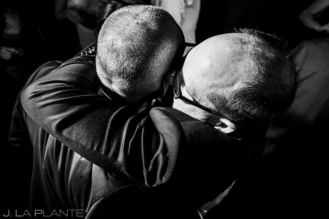 Groom hugging wedding guests | Denver Wedding Photographer | J. La Plante Photo