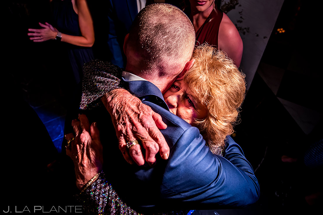 groom hugging his mother on the dance floor