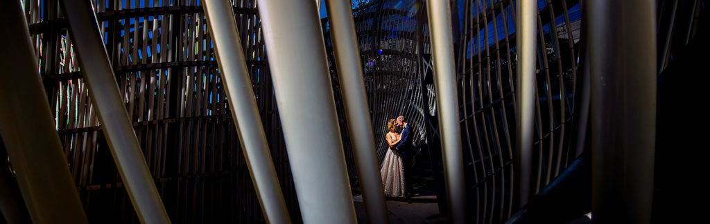Bride and Groom in sculpture | Ironworks Wedding | Denver Wedding Photographer | J. La Plante Photo