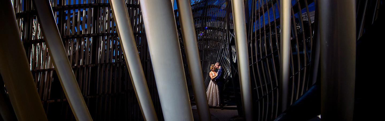 Bride and Groom in sculpture | Ironworks Wedding | Denver Wedding Photographer | J. La Plante Photo