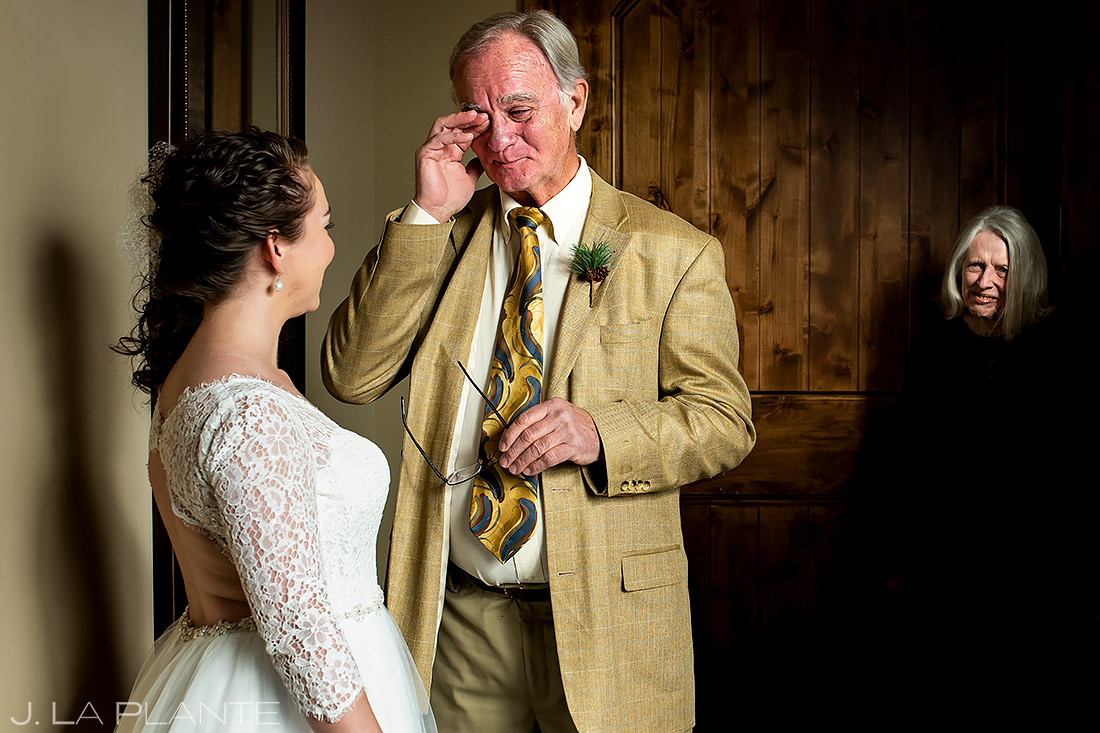 bride's first look with her father in her wedding dress