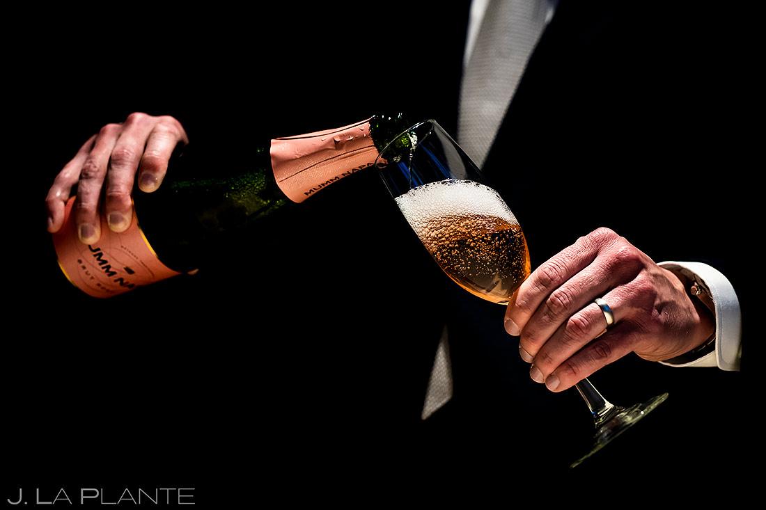 Groom Pouring Champagne | TenMile Station Wedding | Breckenridge Wedding Photographer | J. La Plante Photo