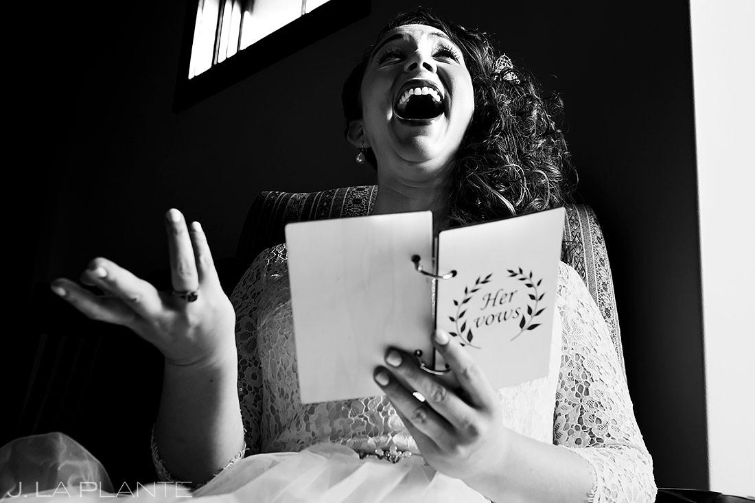 Bride Reading Groom's Letter | Lodge at Cathedral Pines Wedding | Colorado Springs Wedding Photographer | J. La Plante Photo