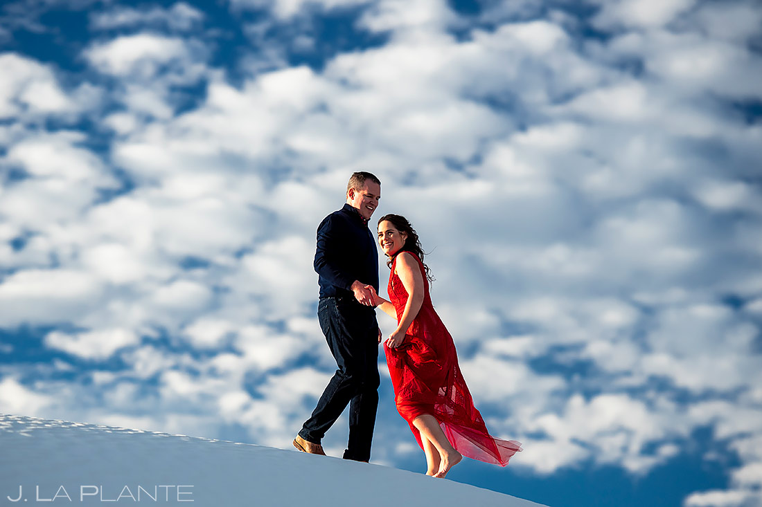 Bride and Groom Climbing Sand Dunes | New Mexico Engagement | Destination Wedding Photographer | J. La Plante Photo