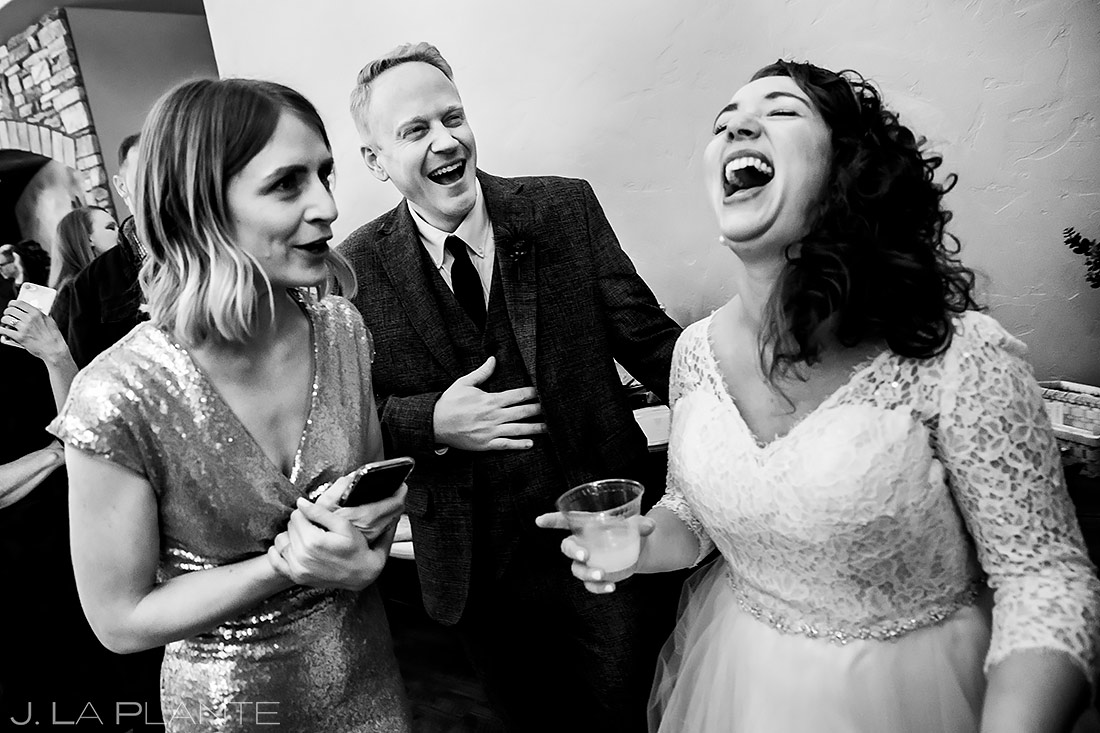 Bride and Groom Laughing Uncontrollably | Lodge at Cathedral Pines Wedding | Colorado Springs Wedding Photographer | J. La Plante Photo